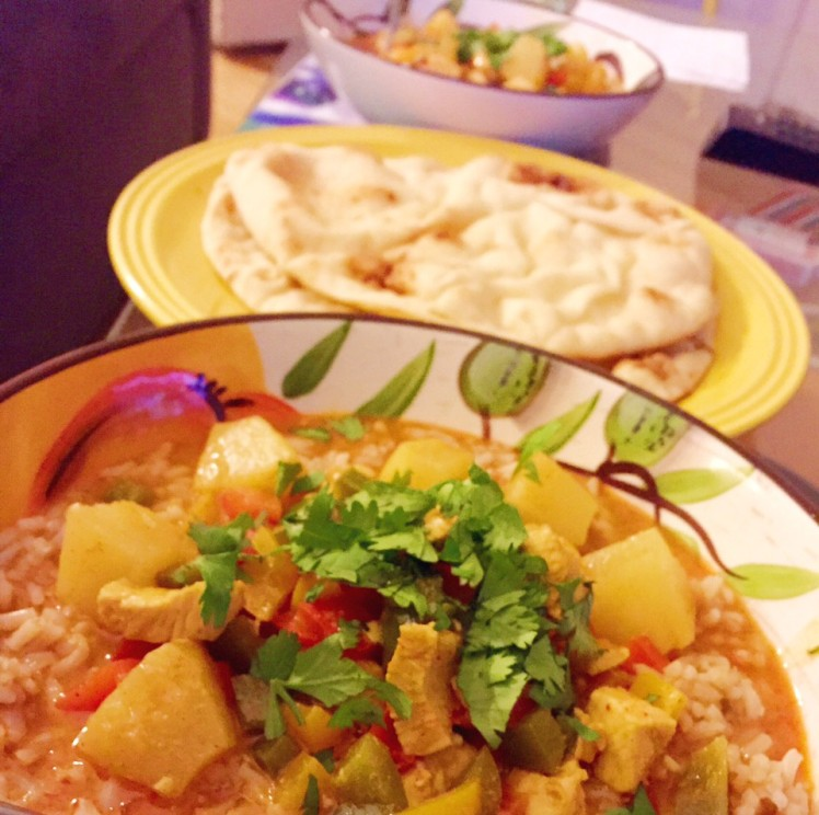 Pineapple Chicken Curry with a side of naan.
